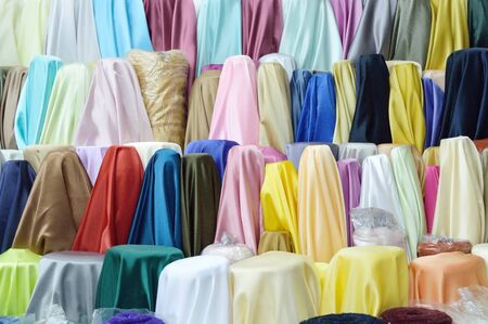 Colored textile in a traditional east market in Thailand photo