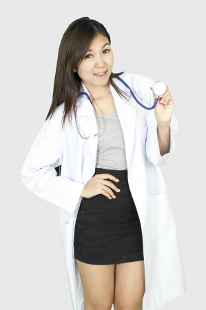 Female Asia doctor or nurse smiling isolated  photo