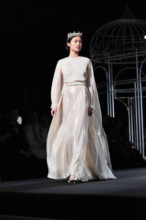 supermodel: BANGKOK, THAILAND - SEP 28 : Model walks the runway at  Theatre  collection presentation during Siam Paragon International Couture Fashion Week 2012 on September 28, 2012 in Bangkok Thailand.  Editorial