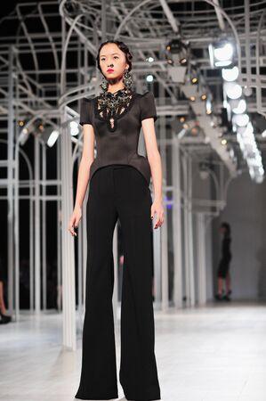 supermodel: BANGKOK, THAILAND - SEP 28 : Model walks the runway at  Flynow  collection presentation during Siam Paragon International Couture Fashion Week 2012 on September 28, 2012 in Bangkok Thailand.