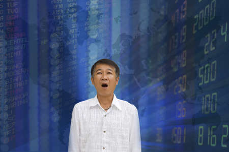 Young businessman with stock exchange graphics on the background  photo