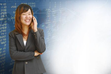 Businesswoman with exchange graphics on the background photo