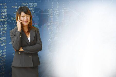 Businesswoman with exchange graphics on the background Stock Photo - 18261051