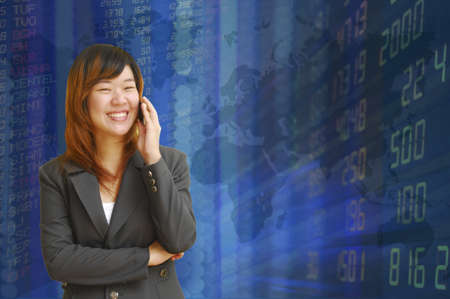 Businesswoman with exchange graphics on the background Stock Photo - 18260921