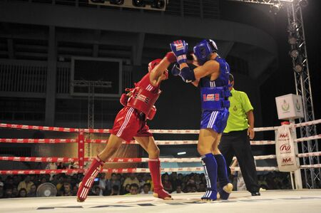 BANGKOK, THAILAND- MARCH 18 : H.Nguye Phu (R) and S.Chanapong (B) in Muaythai World Championship 2013 on March 18, 2013 at Nimitbut Stadium, Bangkok, Thailand