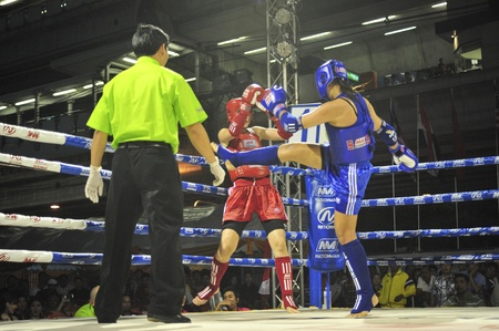 BANGKOK, THAILAND- MARCH 18 : R.Khaled (R) and W.Manghgam (B) in Muaythai World Championship 2013 on March 18, 2013 at Nimitbut Stadium, Bangkok, Thailand  Editöryel