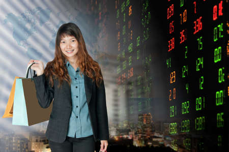 Portrait of business woman   over stock exchange background  photo