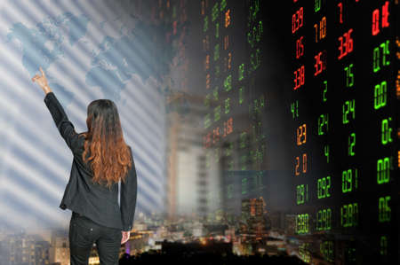 Portrait of smiling business woman   over stock exchange background  photo