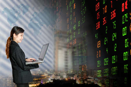 Portrait of smiling business woman   over stock exchange background Stock Photo - 18568646