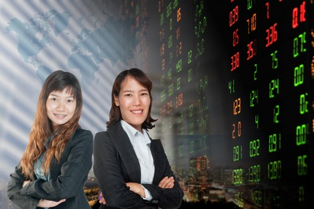 Portrait of smiling business woman . over stock exchange background Stock Photo - 18568616