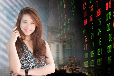 Portrait of smiling business woman . over stock exchange background  photo