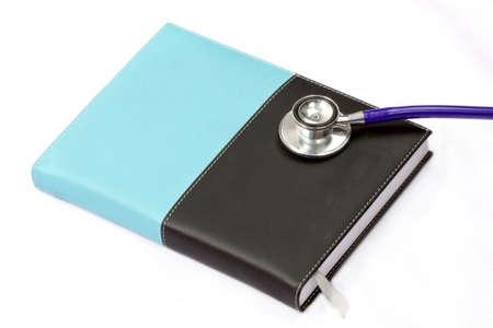 stethoscope and notebook no white banckground Stock Photo - 19835430
