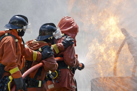 Firefighter fighting For A Fire Attack, During A Training  写真素材