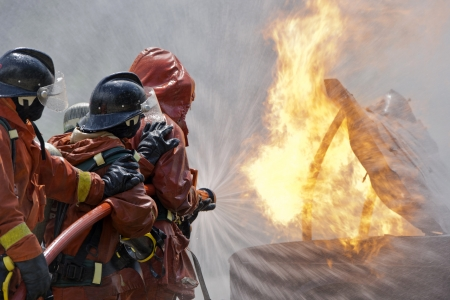 Firefighter fighting For A Fire Attack, During A Training Stock Photo - 20270950