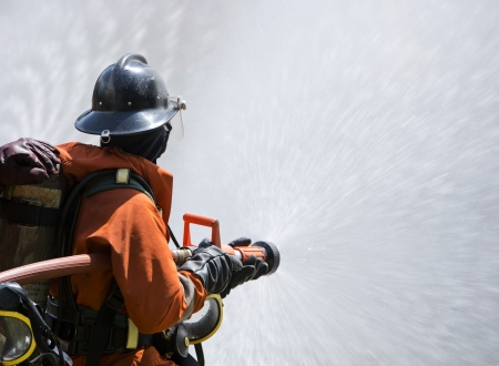Firefighter fighting For A Fire Attack, During A Training  photo