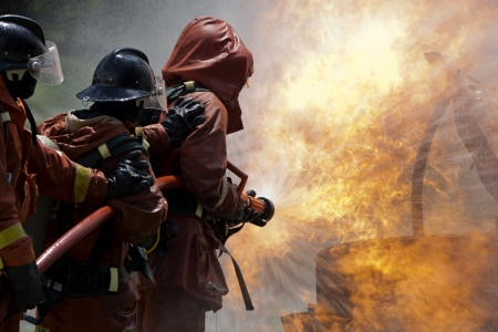Firefighter fighting For A Fire Attack, During A Training  Stock Photo
