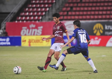 PATUMTANI, THAILAND - JUNE 22 :   Thai Premier League (TPL) between Insee Police UTD. (R) VS Ratchaburi Mitpol Fc (B) at Thammasat stadium on June 22, 2013 in Patumtani,Thailand.