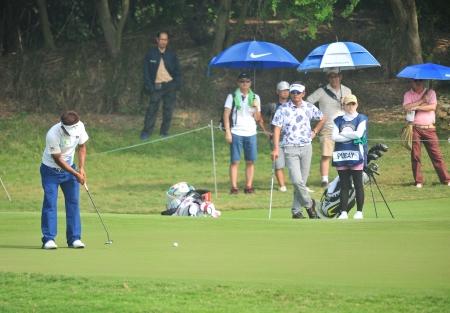 wade: CHONBURI - DECEMBER 14 : Thongchai Jaidee of  Thailand player in aciton during Thailand Golf Championship 2013 at Amata Spring Country Club on December 14, 2013 in Chonburi, Thailand.