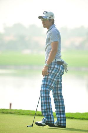 wade: CHONBURI - DECEMBER 14 : Ryo Ishikawa of Japan player in aciton during Thailand Golf Championship 2013 at Amata Spring Country Club on December 14, 2013 in Chonburi, Thailand.  Editorial