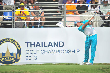 CHONBURI - DECEMBER 14 : Rickie Fowler in aciton during Thailand Golf Championship 2013 at Amata Spring Country Club on December 14, 2013 in Chonburi, Thailand.
