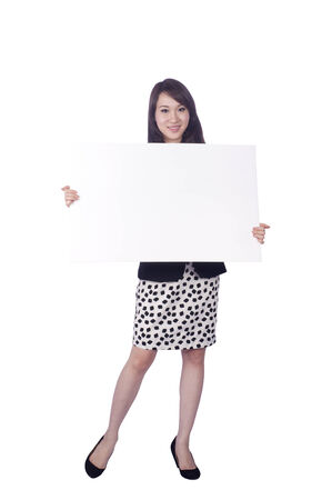 Attractive business woman hold empty blank board, full length portrait isolated on white background photo