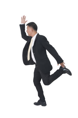 Full length portrait of a happy businessman jumping isolated on white background  photo