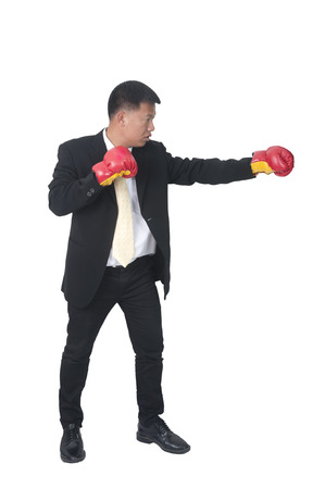 A successful businessman holding boxing gloves up symbolizing conflict  photo