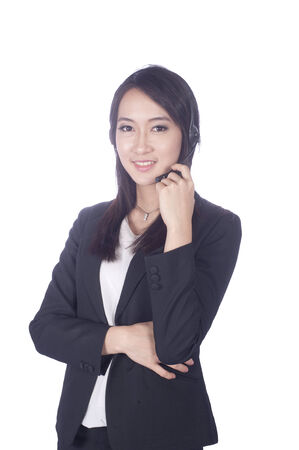 Telemarketing headset woman from call center smiling happy talking in hands free headset device. Multicultural mixed race Chinese Asian  business woman in suit isolated on white background.  photo