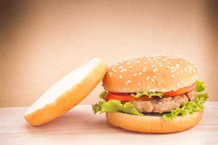 Hamburger closeup on brown background  photo