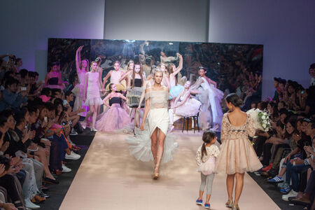 BANGKOK THAILAND-OCT 12 : A model walks on the catwalk showing from TuTu for TUTTI  show at Elle fashion week  AutumnWinter 2014 at Bangkok on Oct 12,2014 inThailand