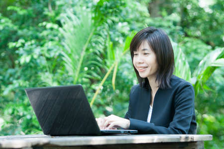 Business woman and laptop - isolated over a white background photo