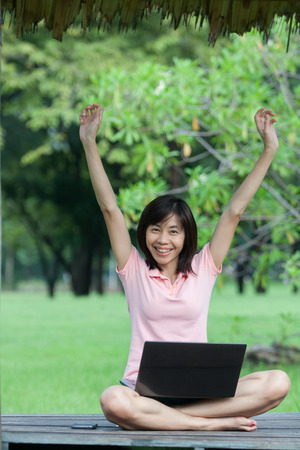 Business woman and laptop in park photo