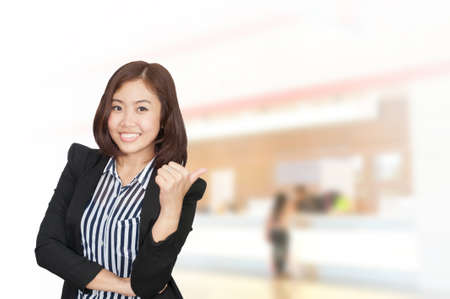 Portrait of young asia business woman in her office.Mixed Asian  Caucasian businesswoman. photo
