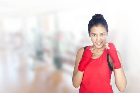 30 year old: Young beautiful woman 20 - 30 year old during fitness time and exercising in gym