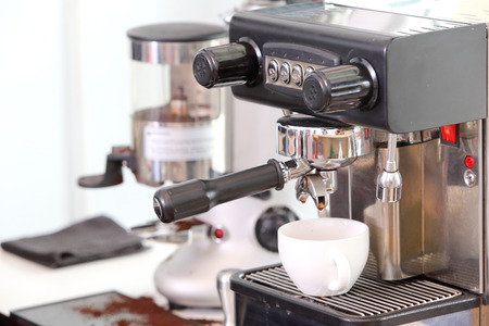 Professional coffee machine making espresso in a cafe photo