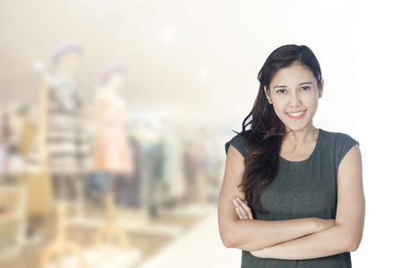 30 year old: portrait asian businesswoman 20 - 30 year old with long hair has shopping mall .Mixed Asian  Caucasian businesswoman.Positive emotion Stock Photo