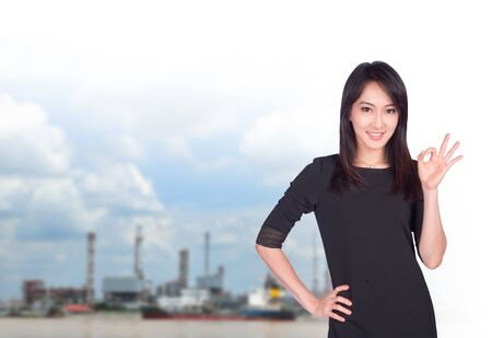 portrait of young asia businesswoman has oil industry.office.Mixed Asian  Caucasian businesswoman. Positive emotion photo