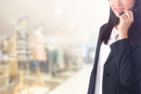 30 year old: portrait asian businesswoman 20 - 30 year old with long hair has shopping mall background.Mixed Asian  Caucasian businesswoman.Positive emotion