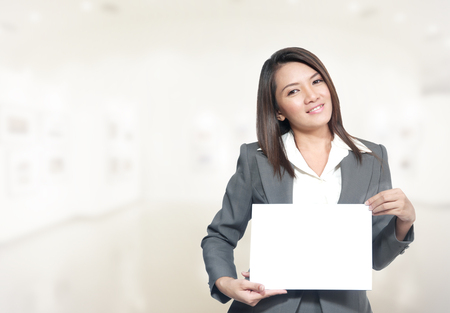 30 year old: Portrait of young asia business woman 20 - 30 year old in her office.Mixed Asian  Caucasian businesswoman.Positive emotion Stock Photo