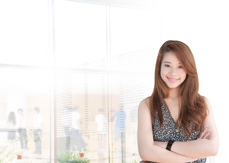 30 year old: Portrait of young asia business woman 20 - 30 year old in her office.Mixed Asian  Caucasian businesswoman.Positive emotion Editorial