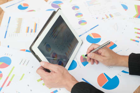 examine: Businessman examine finance, tax, accounting, statistics and analytic research concept Stock Photo
