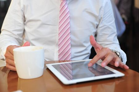 rowth: Young businessmen using touchpad at meeting  Focus touchscreen to tablet for present