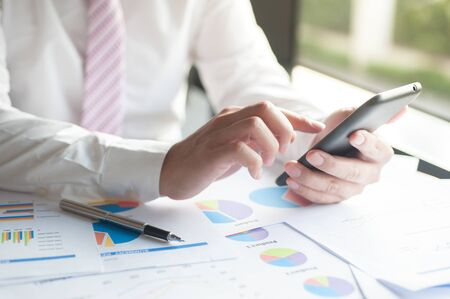 examine: Businessman examine finance, tax, accounting, statistics and analytic research for restructure concept