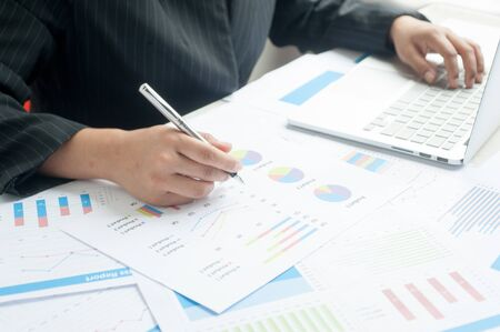 to examine: Businesswoman examine finance, tax, accounting, statistics and analytic research concept Stock Photo