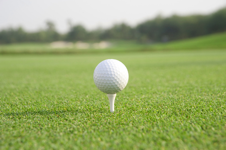 holed: Golf ball on tee ready to be shot