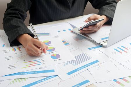 examine: Businesswoman examine finance, tax, accounting, statistics and analytic research concept Stock Photo