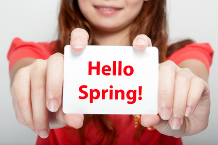 spring message: Businesswoman showing card with hello spring message,
