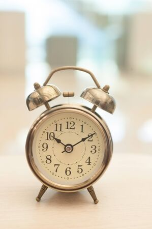 counting five: Vintage background with retro alarm clock on table