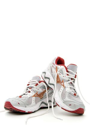 Pair of running shoes on a white background Imagens