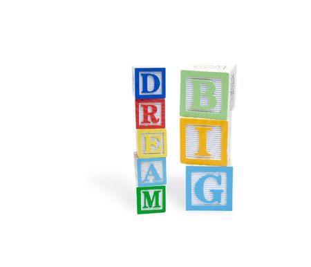 Wooden block letters spelling dream big photo